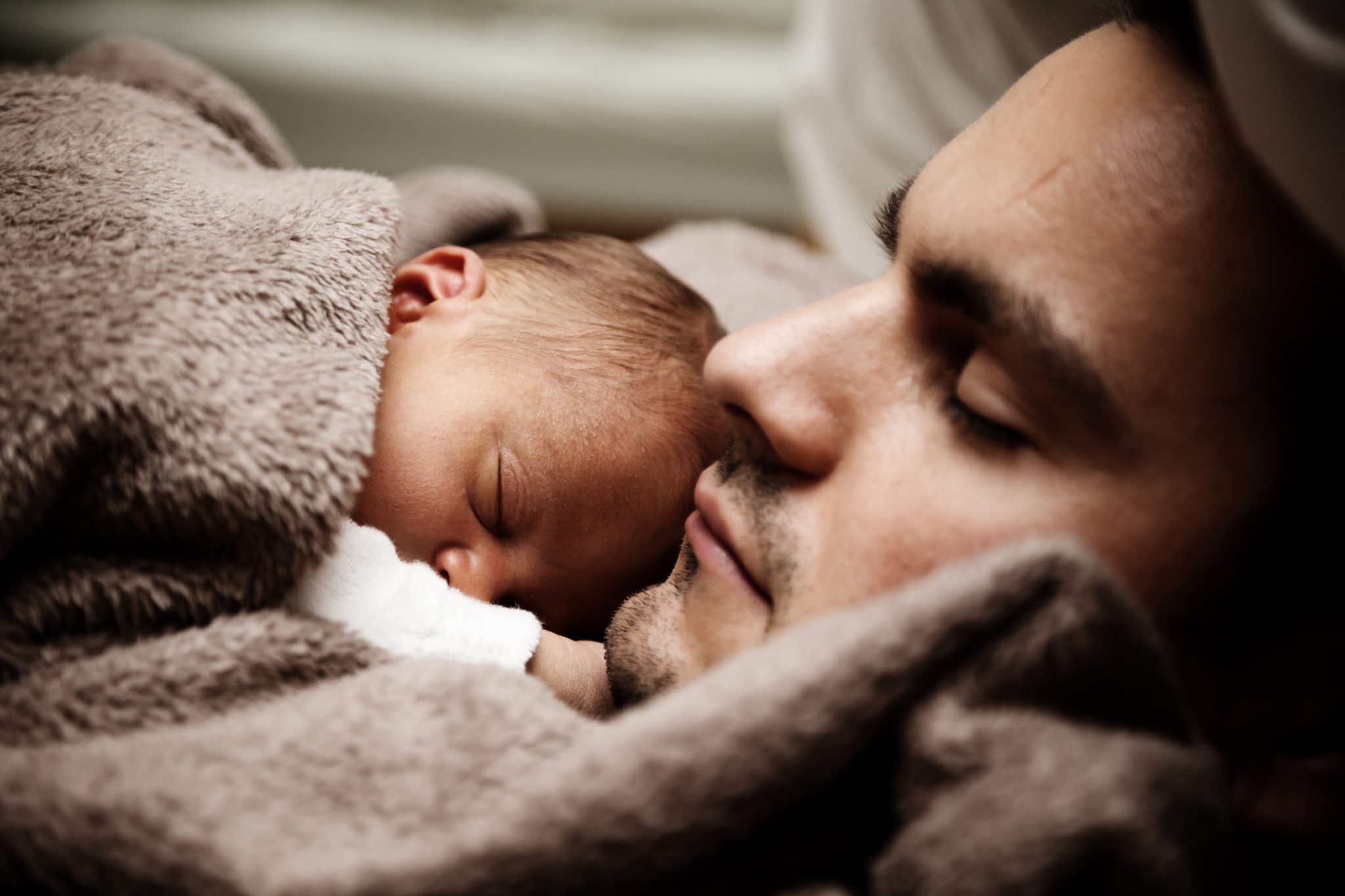 father and child sleeping